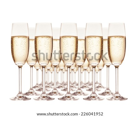 Group of champagne glasses isolated on white background - stock photo