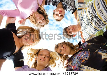 Group of cheerful friends embracing