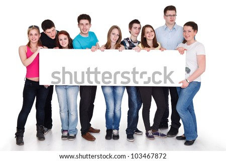 group of cheerful people holding a banner ad isolated over a white background - stock photo