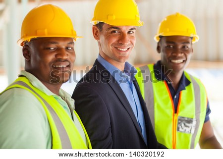 group of cheerful professional construction manager and workers - stock photo