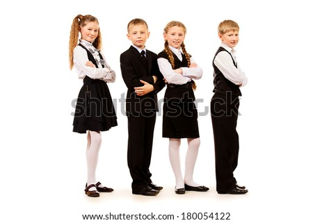 Group of cheerful schoolchildren standing together. Isolated over white.
