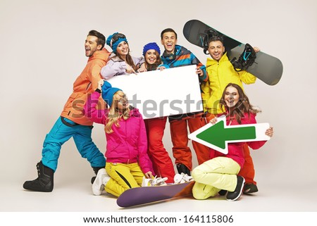 Group of cheerful snowboarders friends  - stock photo