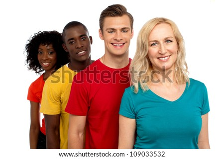Group of cheerful teenagers standing in a line. All on white background
