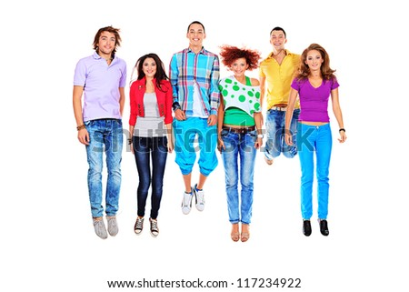 Group of cheerful young people jumping together. Isolated over white background. - stock photo