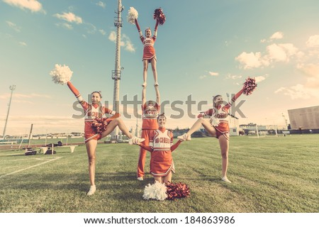 Group of Cheerleaders in the Field - stock photo