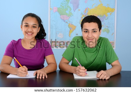 Group of children doing work in their school - stock photo