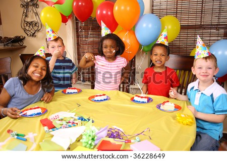 Group of children eating cake at birthday party