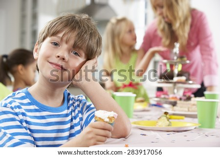 Group Of Children Enjoying Birthday Party Food At Table - stock photo