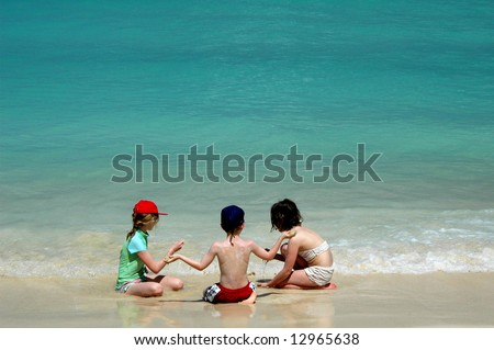 group of children on tropical beach - stock photo