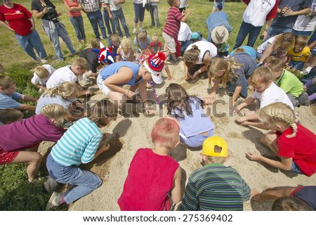 Group of children playing a game in the sand