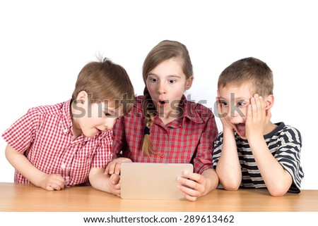 Group of Children Playing Exciting Game on Tablet, Half-Length Studio Shot Isolated on White - stock photo