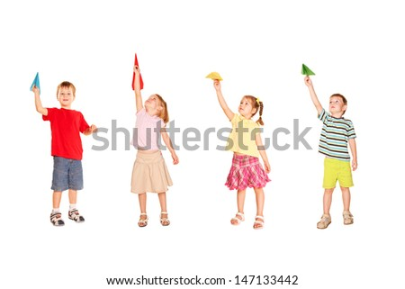 Group of children playing with paper airplanes, holding in hands, starting them fly up,  ready for your text, logo or symbols.Isolated on white background. - stock photo