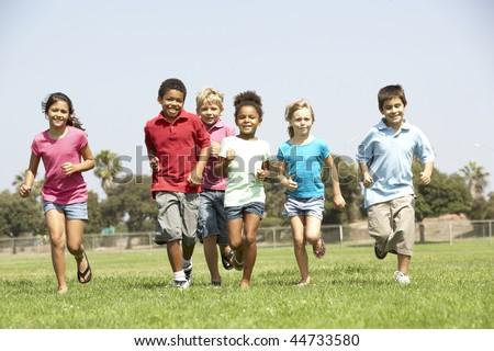 Group Of Children Running In Park - stock photo