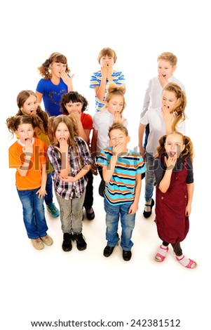 Group of children standing together and yawn. Isolated over white. - stock photo