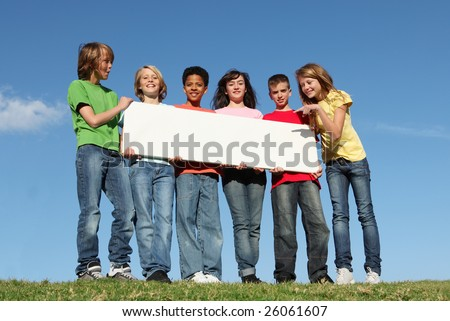 group of children with blank poster