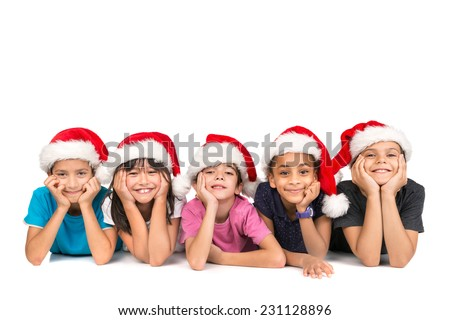 Group of children with Santa's hat posing isolated in white - stock photo