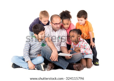 Group of children with teacher reading a story isolated in white