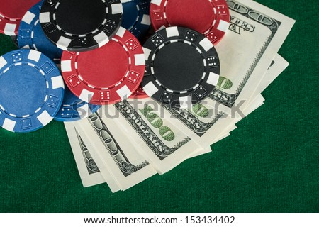 Group of chips and money on the green cloth.