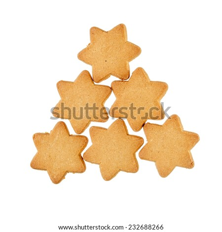 Group of christmas ginger bread cookie stars isolated over white - stock photo