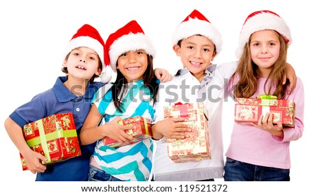 Group of Christmas kids holding their presents - isolated over a white background - stock photo