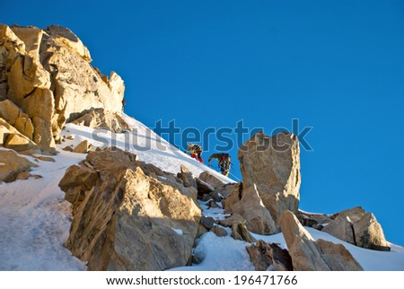 Group of climbers in the mountain - stock photo