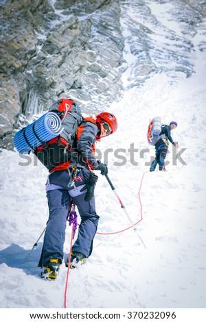Group of climbers reaching the summit. Nepal - stock photo