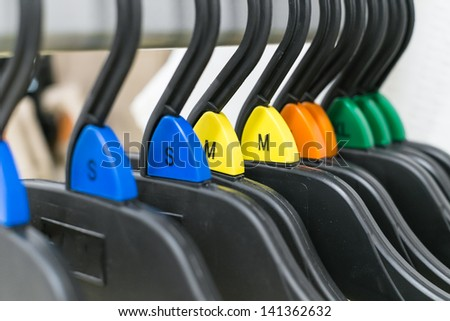 group of cloth hanger with various color sizing label in angle - stock photo