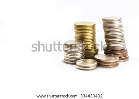 group of coins stacking up in white isolated background.