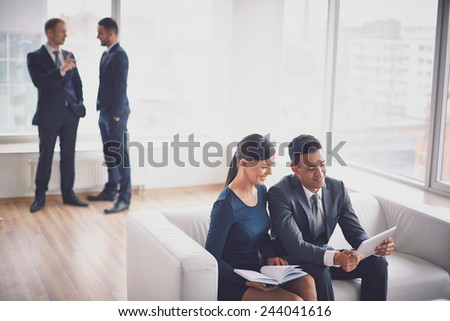 Group of colleagues working in office - stock photo