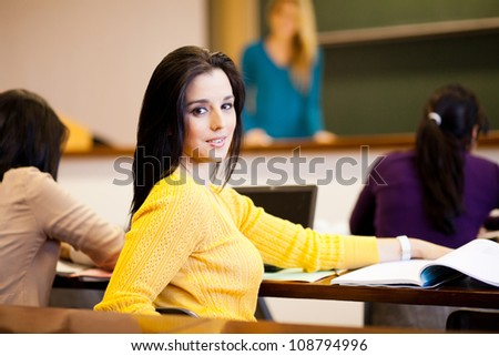 group of college students in lecture hall - stock photo