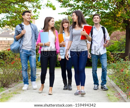 Group of college students walking together - stock photo
