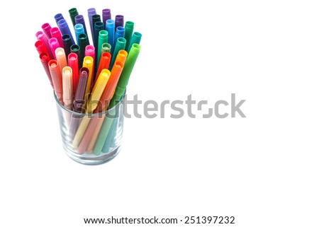 Group of color felt-tipped pens in a glass, white background, isolated - stock photo