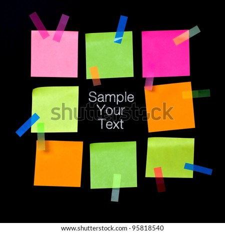 Group of colored note s for taking notes on a black background - stock photo