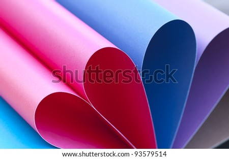 Group of colored paper sheets in unusual shape. Back to school concept.
