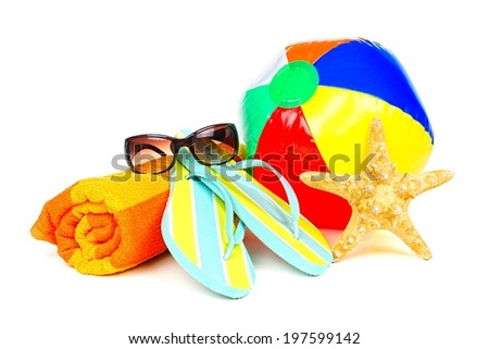 Group of colorful beach items over a white background - stock photo