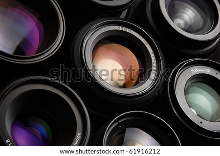 Group of colorful camera lenses - stock photo