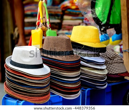 Group of colorful hats at a market stall