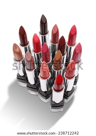 Group of colorful lipsticks isolated on white background - stock photo