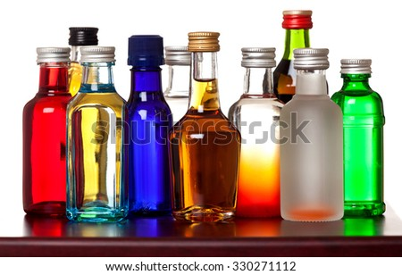 Group of colorful little bottles - stock photo