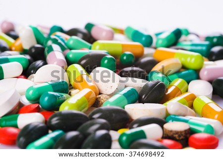 group of colorful pills on white
