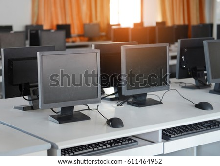 Group of computers neatly placed in a computer lab.
