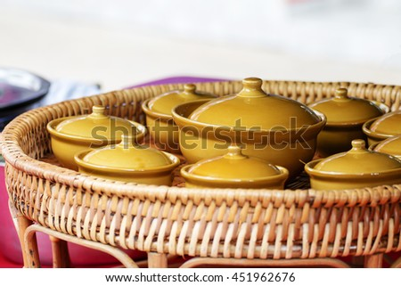 Group of condiment cup in wicker tray. - stock photo