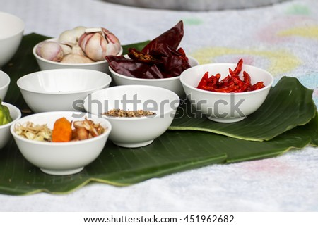 Group of condiment cup on banana leaf - stock photo