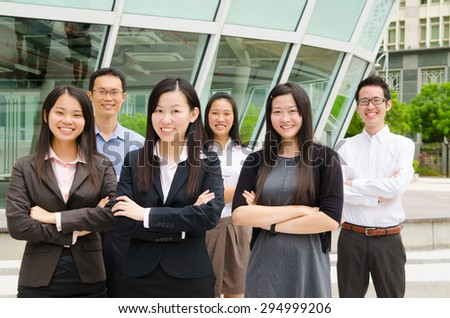 Group of confident asian business executives - stock photo