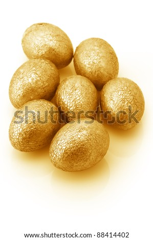 Group of crackle golden Easter eggs isolated on white background. - stock photo