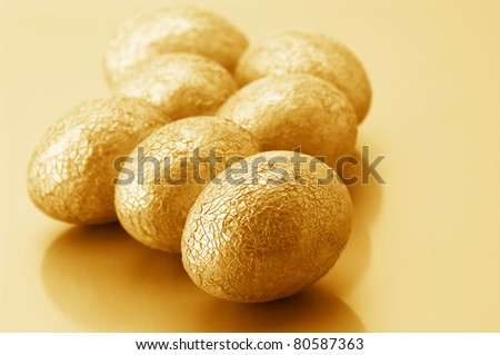 Group of crackle golden Easter eggs on golden background. - stock photo