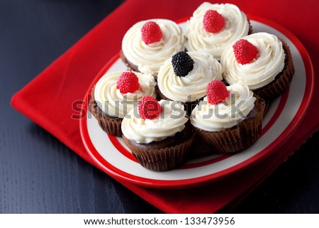 Group of cupcakes with blackberry and raspberry