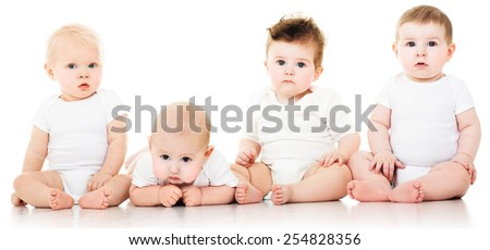Group of cute  babies, crawling, over white. playing babies