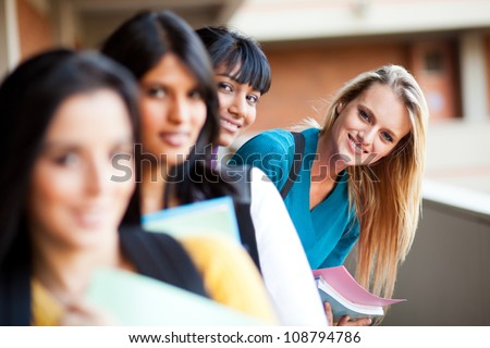 group of cute university students portrait together - stock photo