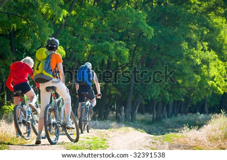group of cyclists at morning - stock photo